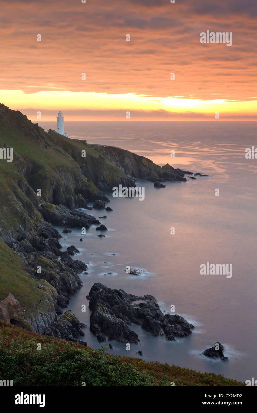 Spectacular sunrise behind Start Point Lighthouse in South Hams, Devon, England. Autumn (September) 2010. - Stock Image