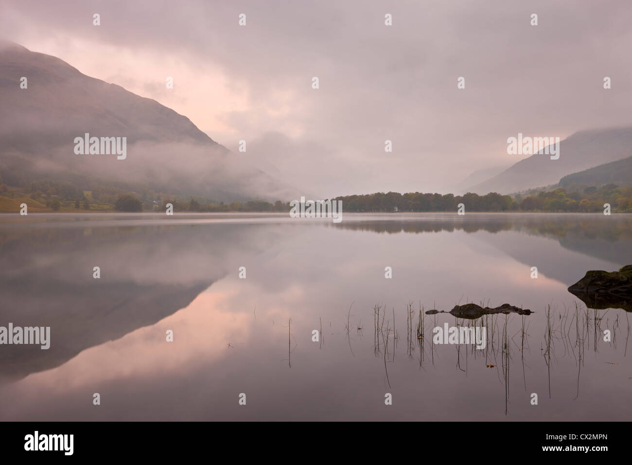 Mist over Loch Voil at dawn, The Trossachs, Scotland. Autumn (October) 2010. - Stock Image