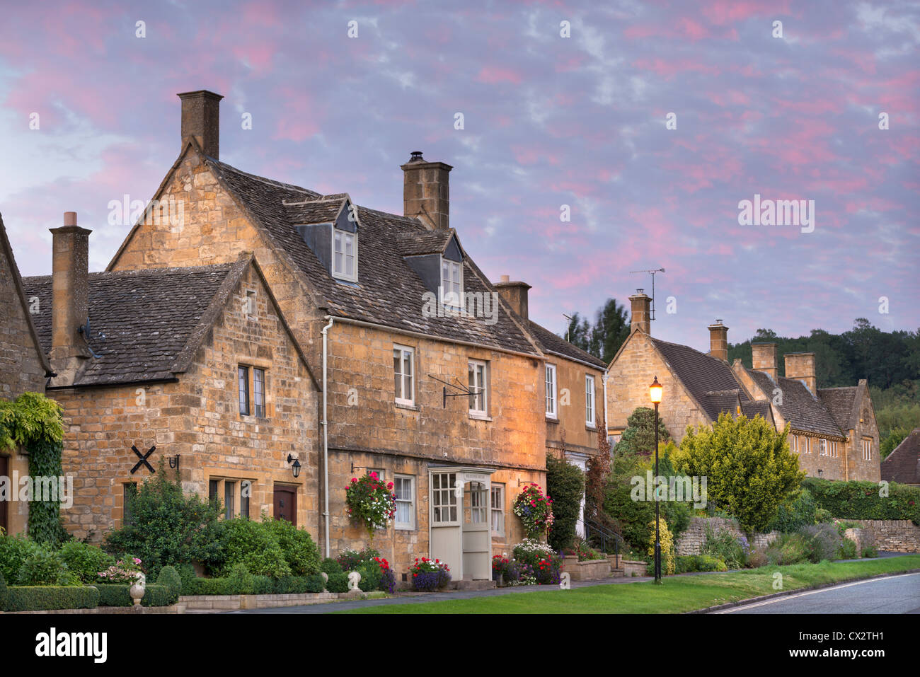 Pretty houses in the picturesque Cotswolds village of Broadway, Worcestershire, England. Autumn (September) 2012. - Stock Image