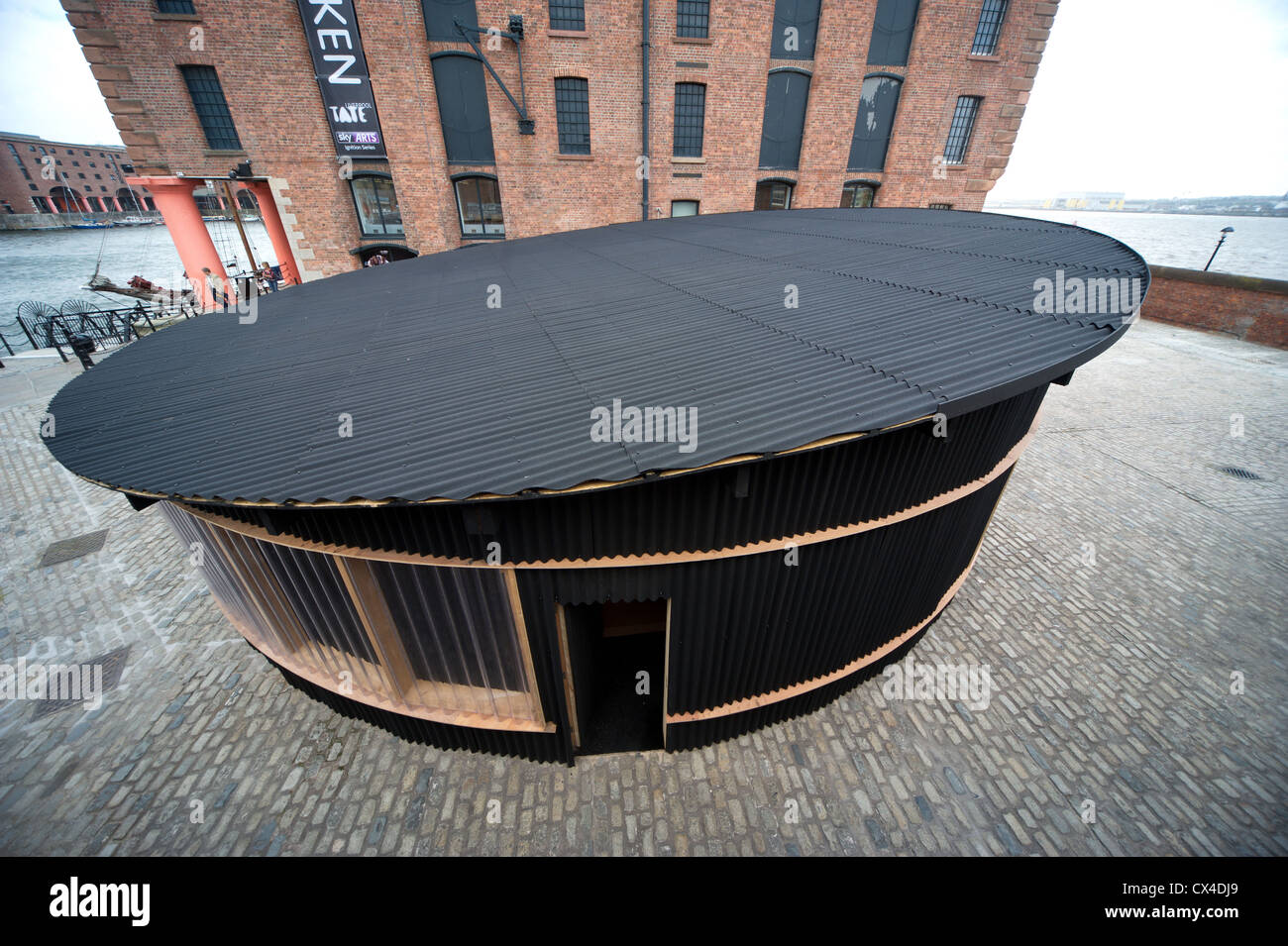 Designed by architect to the stars David Adjaye, this pavillion hosts Doug Aitken's new art installation Source. - Stock Image
