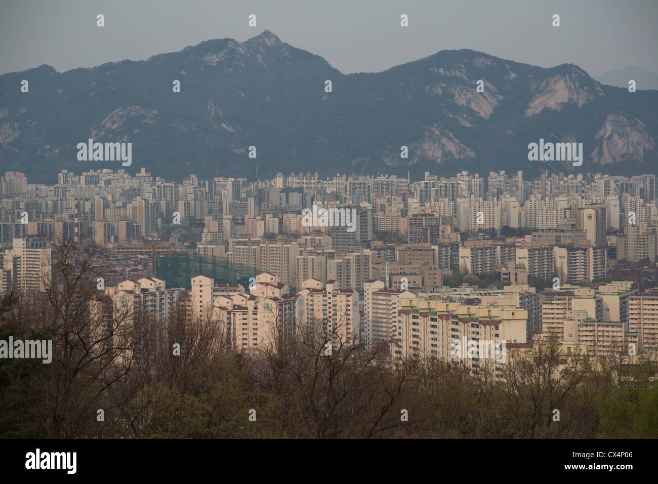 Hundreds of high rise apartment buildings crowded together near the mountains in Seoul, South Korea - Stock Image