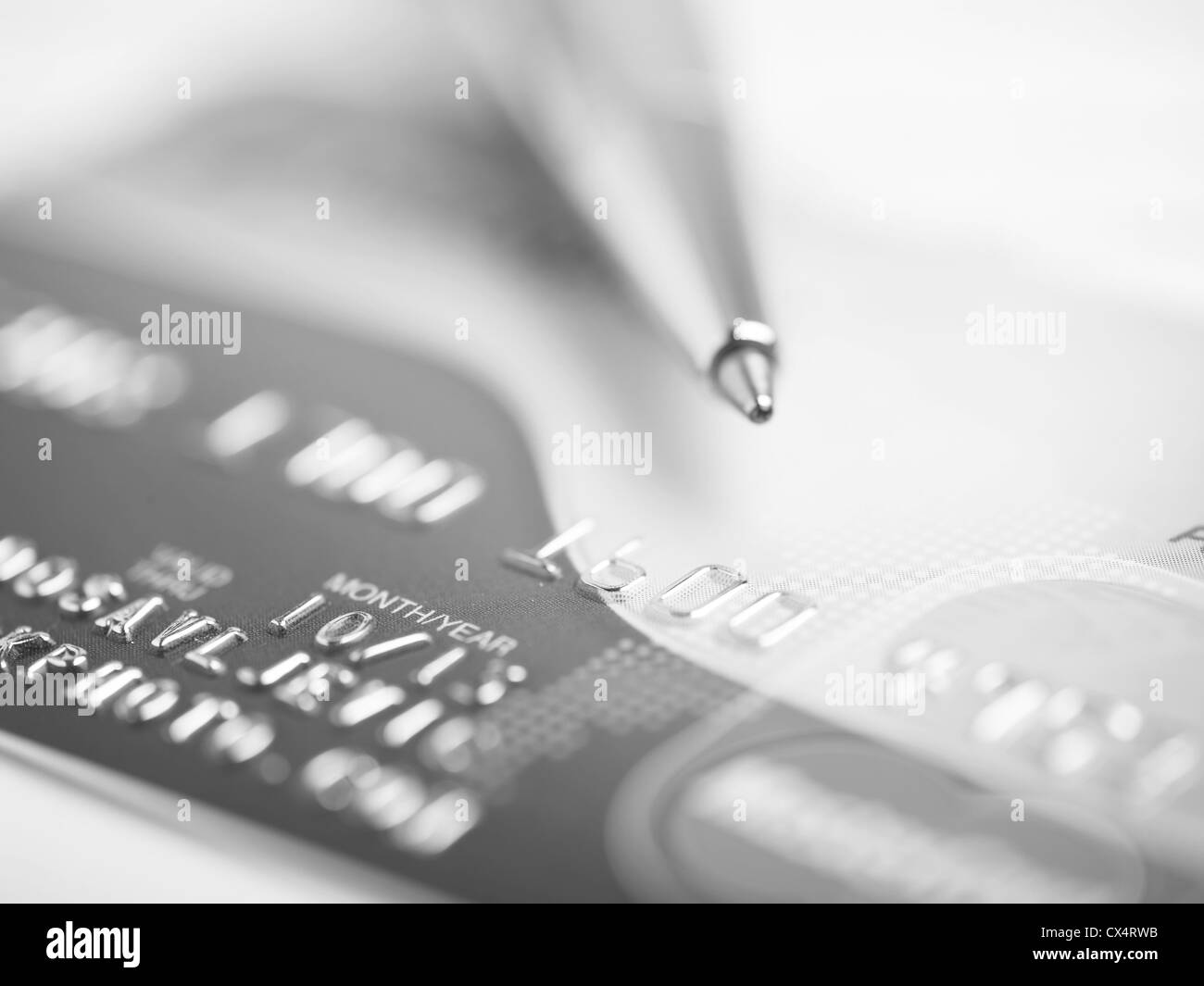 Close up a credit card and pen - Stock Image