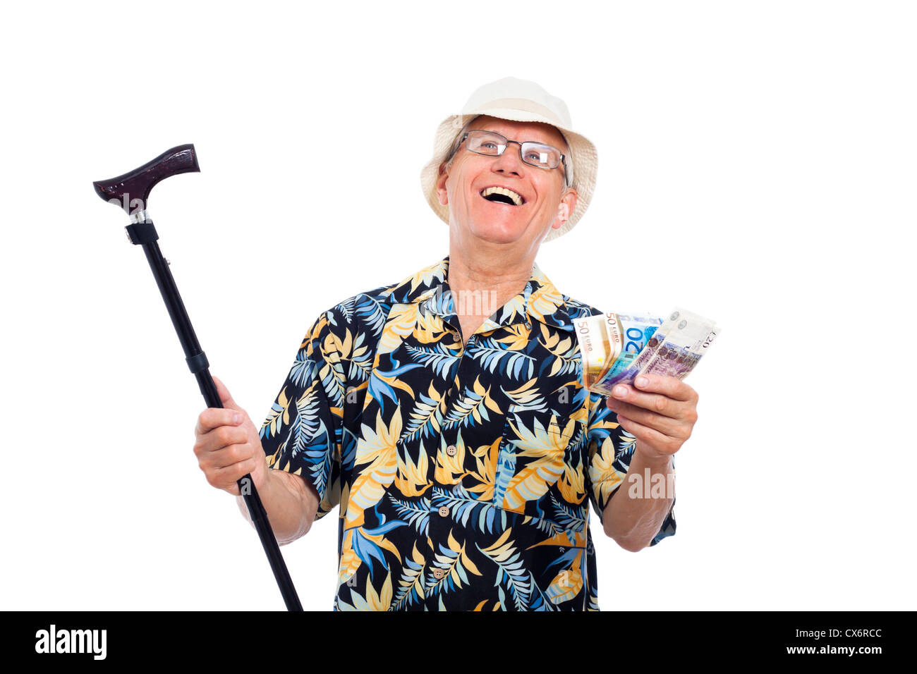Happy excited wealthy senior man holding money and cane, isolated on white background. - Stock Image