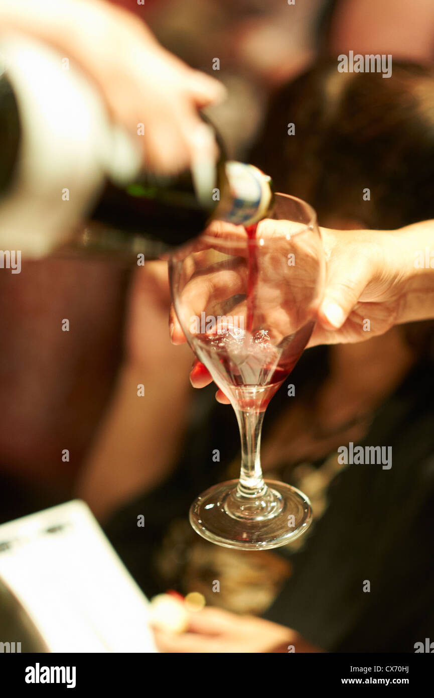 pouring wine - Stock Image