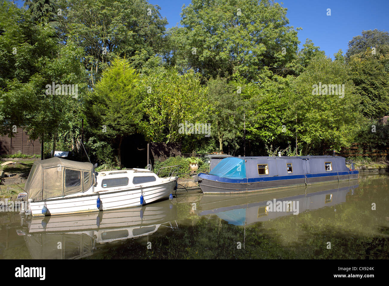 Boats on the Grand Union Canal, Warwickshire, England, UK, narrow, boat, cruiser, boats, boating, narrowboat, narrowboats, - Stock Image