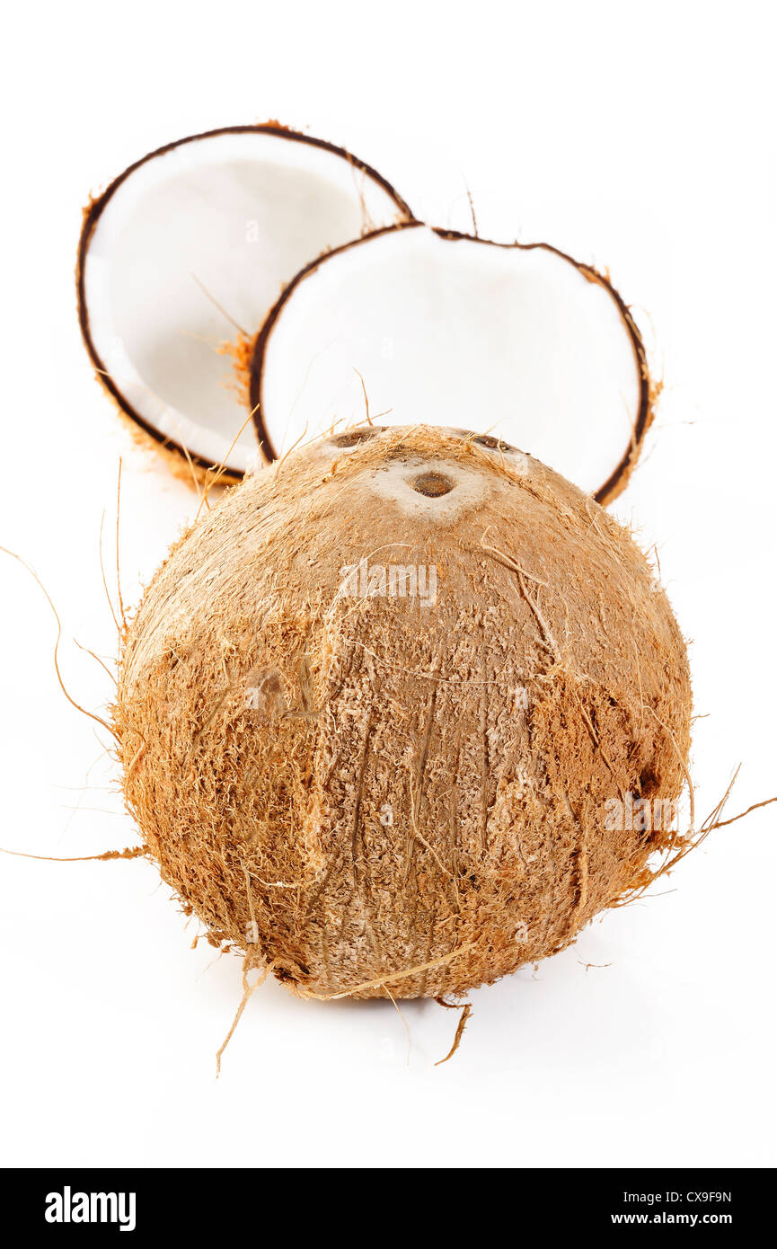 Coconut shell on white - Stock Image