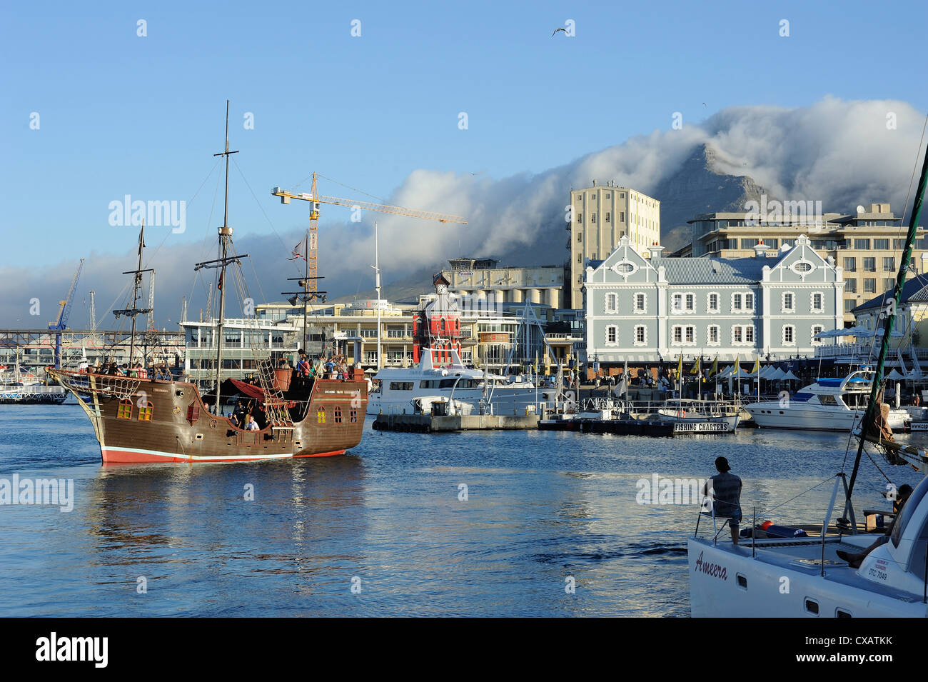 Replica pirate ship, Waterfront harbour, Table Mountain in background, Cape Town, South Africa, Africa - Stock Image
