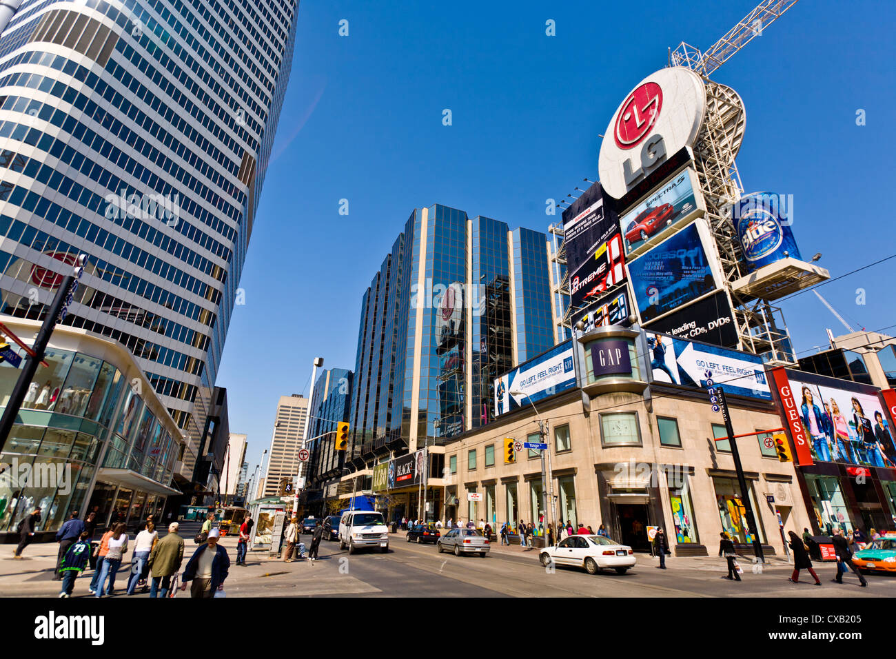 Intersection of Young Street and Dundas Street, showing part of Eaton Center, as viewed from Dundas Square, Toronto, - Stock Image