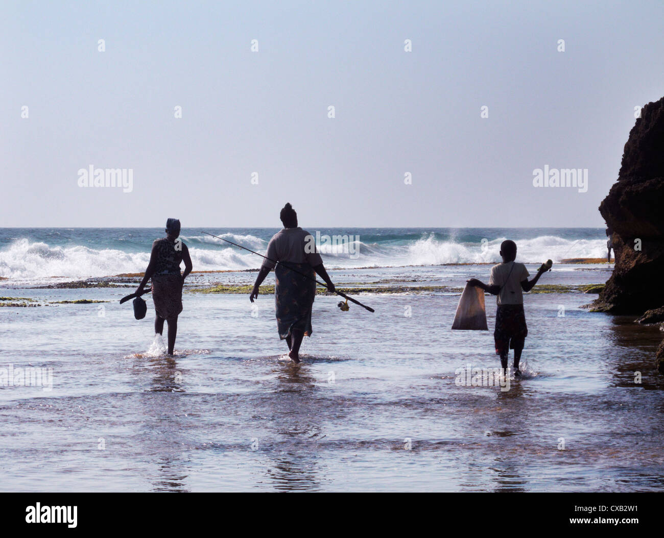 Family going fishing. Ponta do Ouro, southern Mozambique. - Stock Image