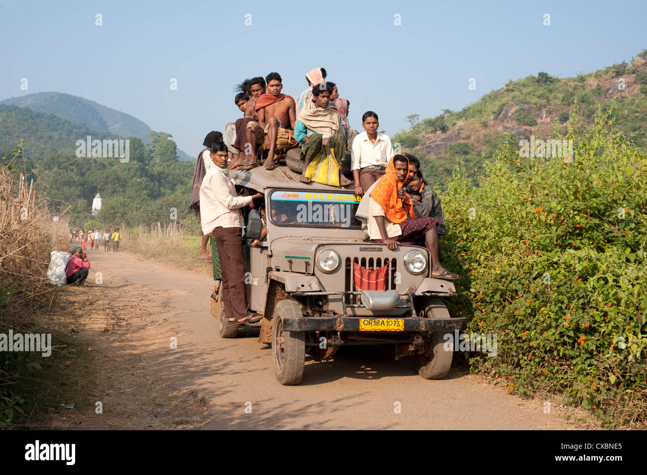 Overloaded village jeep carrying Dunguria Kondh tribesmen to local tribal market, Bissam Cuttack, Orissa, India, - Stock Image