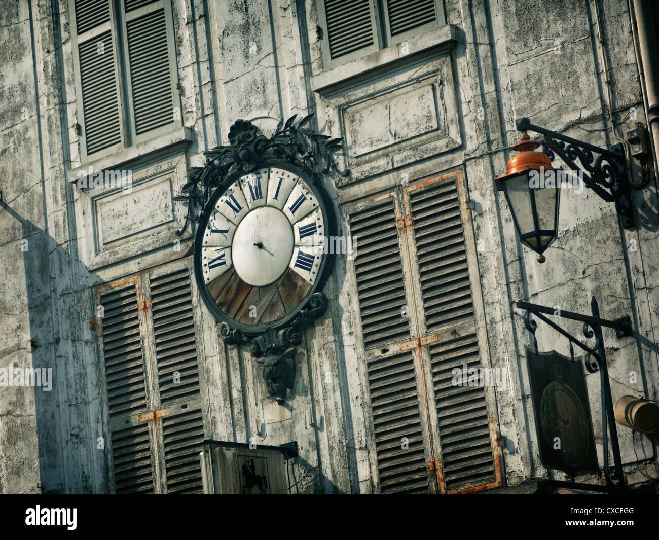 Broken clock in a village near Paris, France - Stock Image