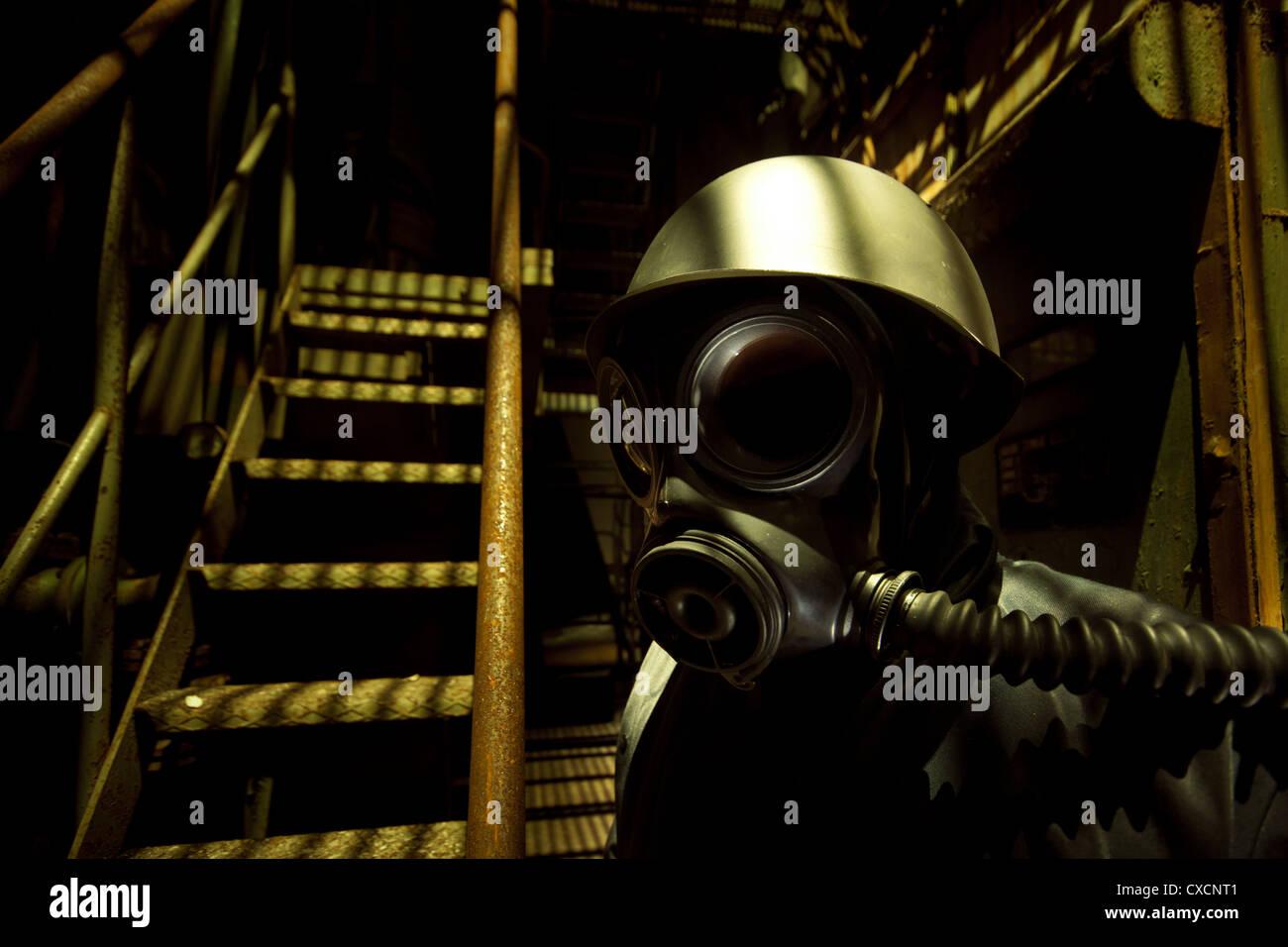 Ominous gas masked individual - Stock Image