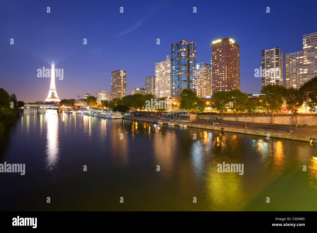 Night view of River Seine with high-rise buildings on the Left Bank, and Eiffel Tower, Paris, France, Europe - Stock Image