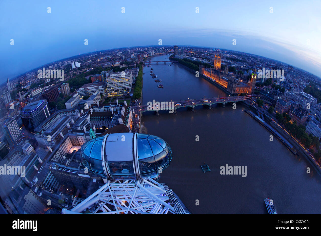 View of passenger pod capsule, Houses of Parliament, Big Ben and the River Thames from the London Eye at dusk, London, - Stock Image