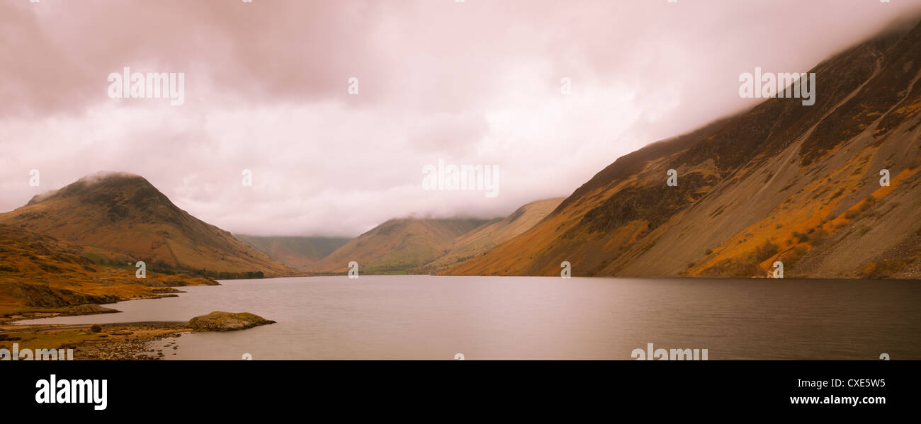 Panoramic view of Wast Water, with Scafell Pike and Great Gable covered in cloud, Lake District National Park, Cumbria, - Stock Image