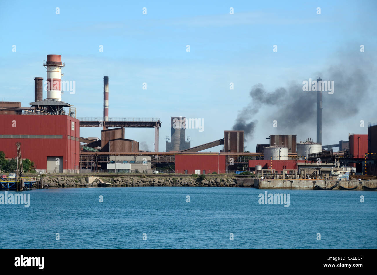 Smoke Stacks and Air Pollution from the ArcelorMittal Steelworks Martigues Autonomous Port of Marseille or Marseilles - Stock Image