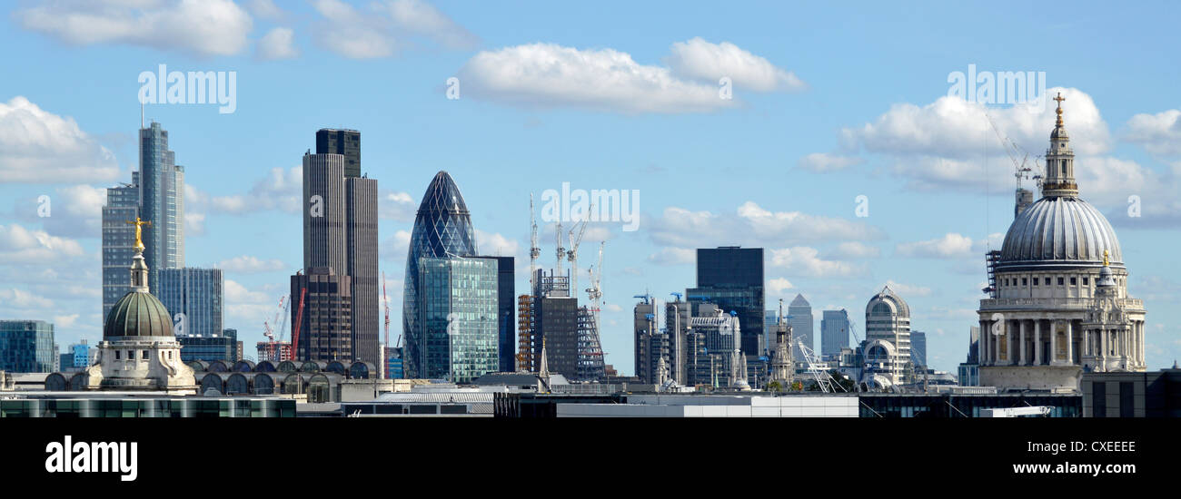 City of London skyline buildings including Tower 42, Gherkin, Lloyds, Canary Wharf distant, & Dome of St Pauls - Stock Image