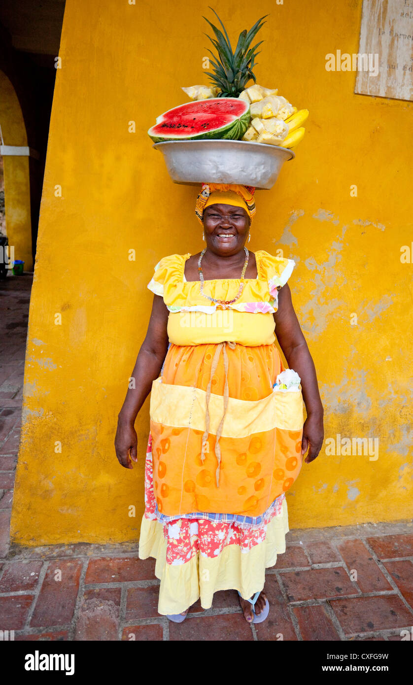 Full length portrait of traditional fruit sellers from Palenque (Palenquera), Cartagena de Indias, Colombia, South - Stock Image