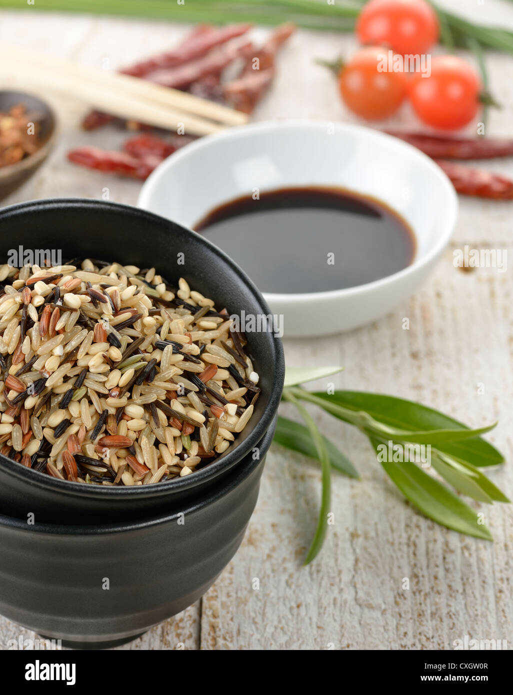 Wild Rice And A Soy Sauce In The Bowls - Stock Image