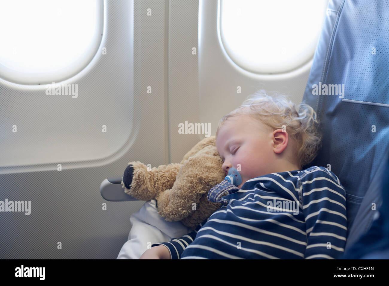 Germany, Boy sleeping in plane - Stock Image