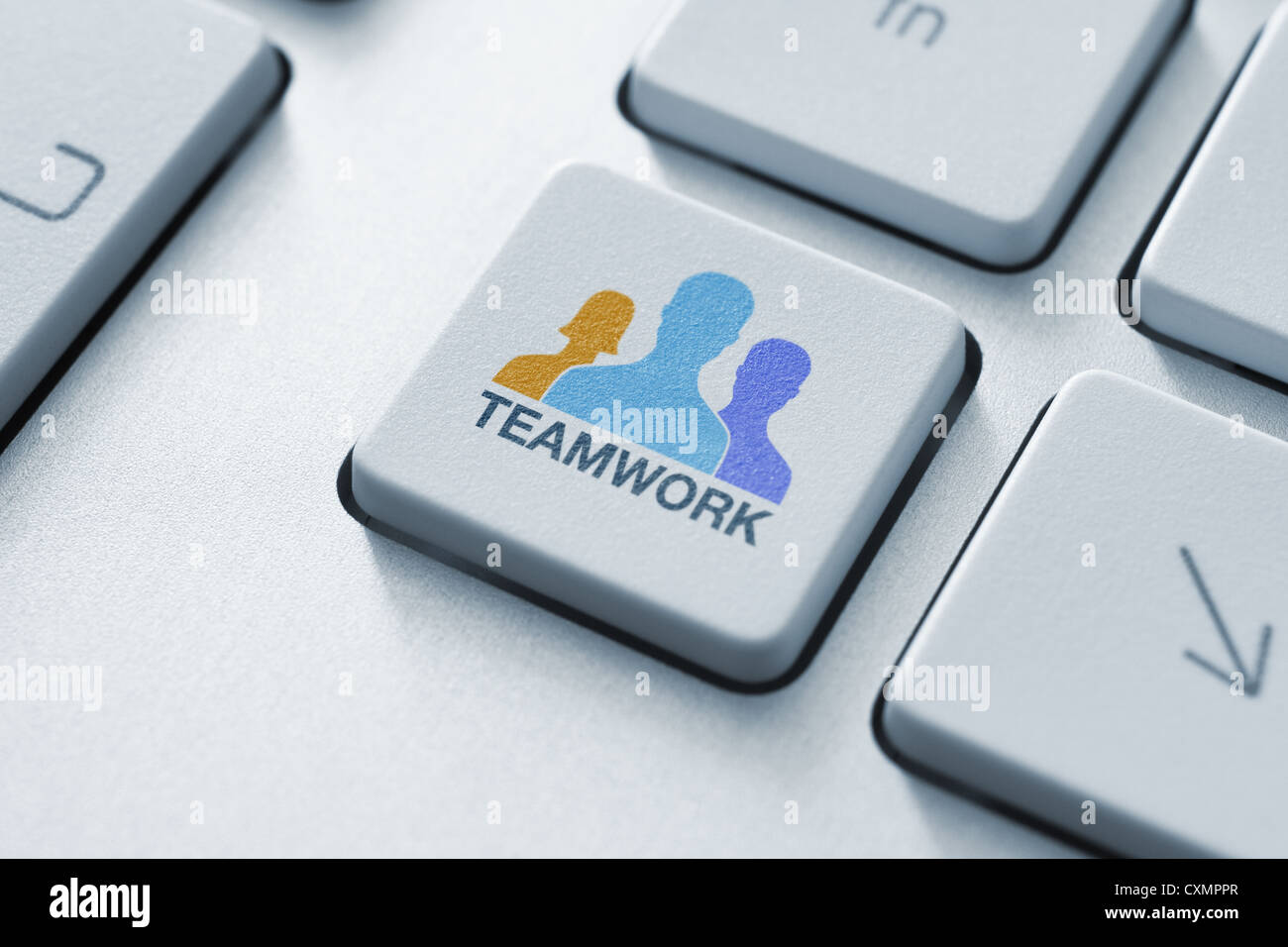 Teamwork key on keyboard concept. Toned image. - Stock Image