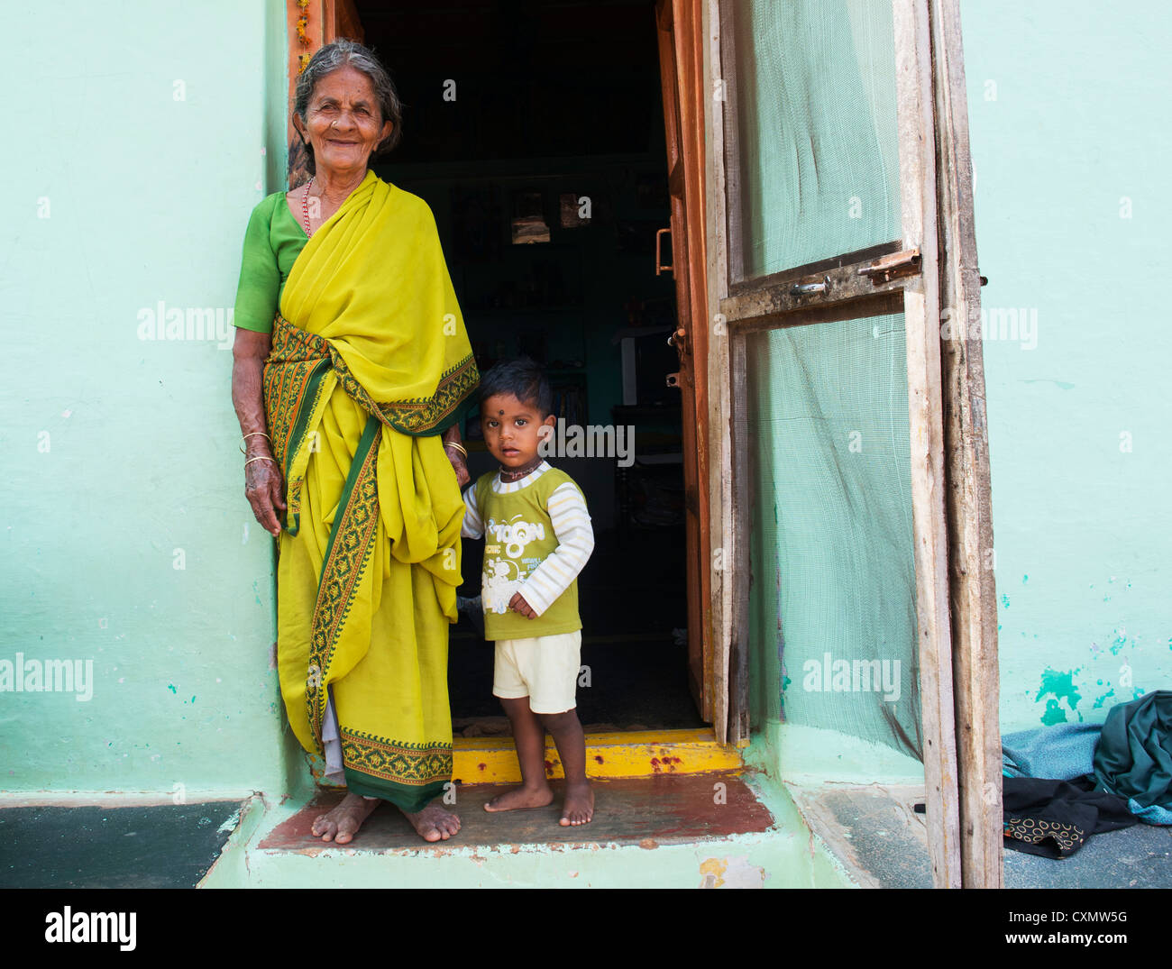 Indian grandmother and baby boy in a rural indian village. Andhra Pradesh, India - Stock Image