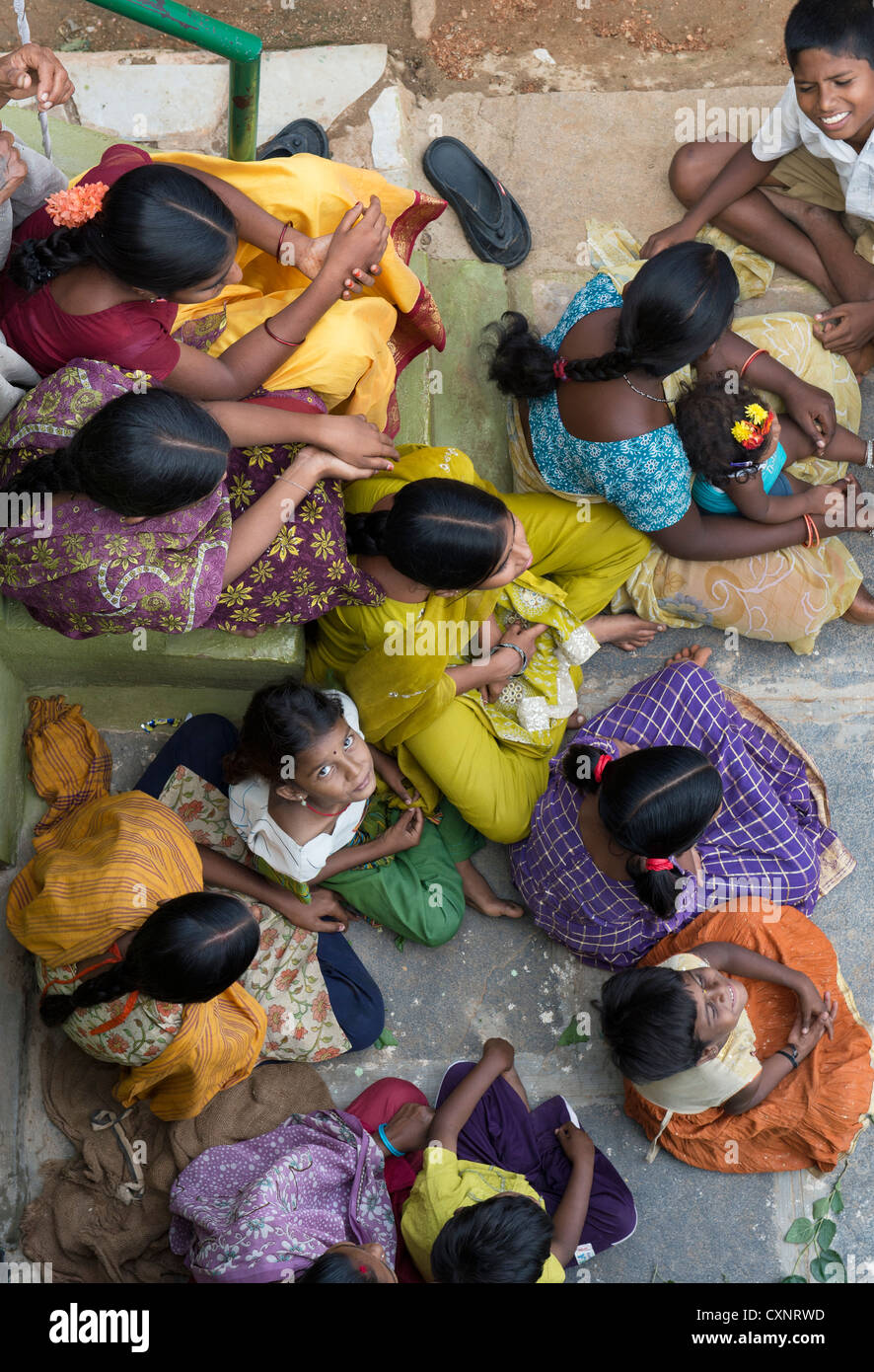 Group of indian girls sitting outside there home in a rural indian village from above. Andhra Pradesh, India - Stock Image