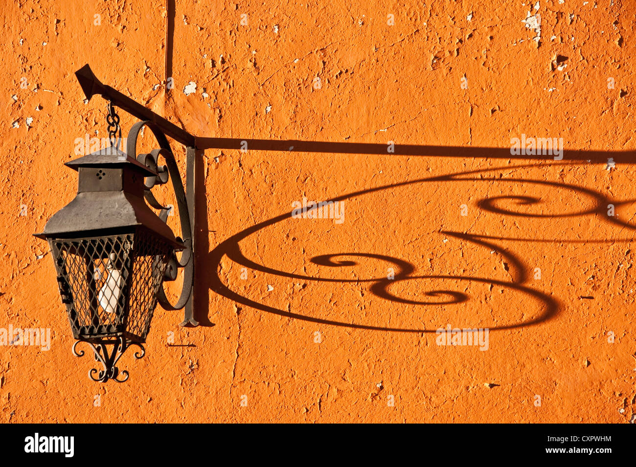 San Miguel de Allende wrought iron lamp on residence near El Jardin central square - Stock Image