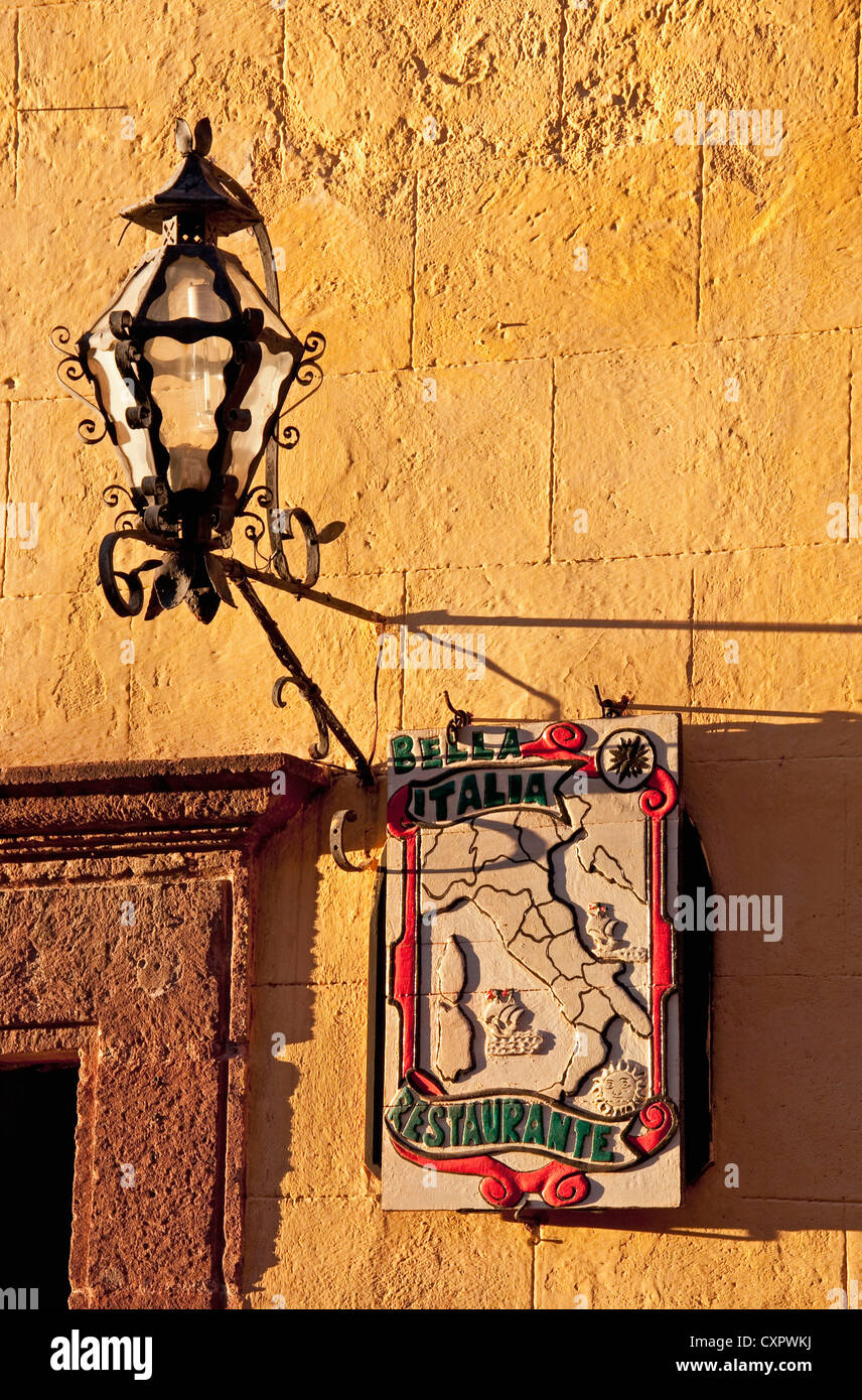 San Miguel de Allende lamp and sign for Bella Italia Restaurante near El Jardin central square - Stock Image