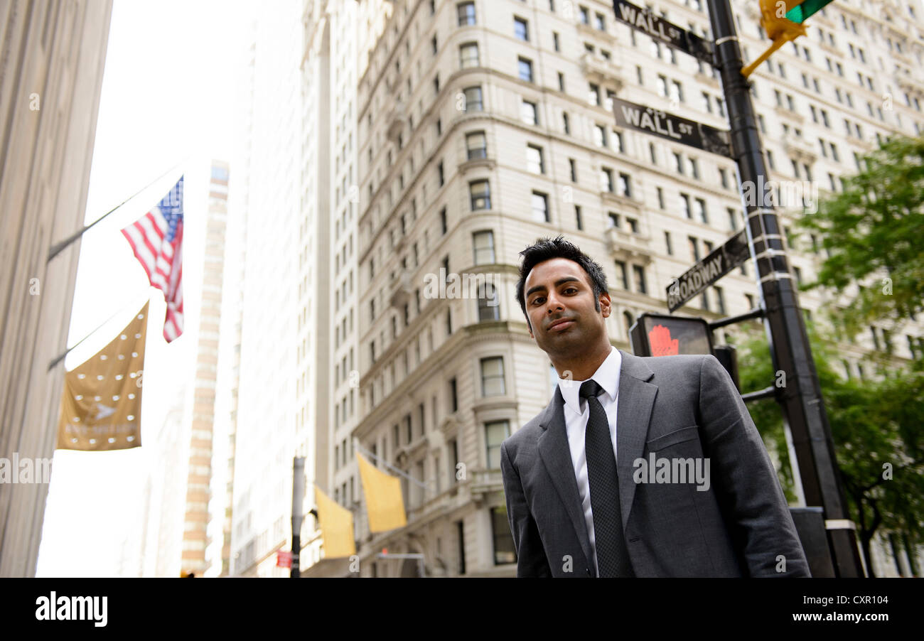 Businessman on Wall Street, New York City - Stock Image
