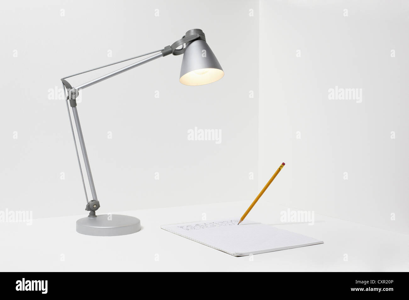 Lamp, pencil and paper - Stock Image
