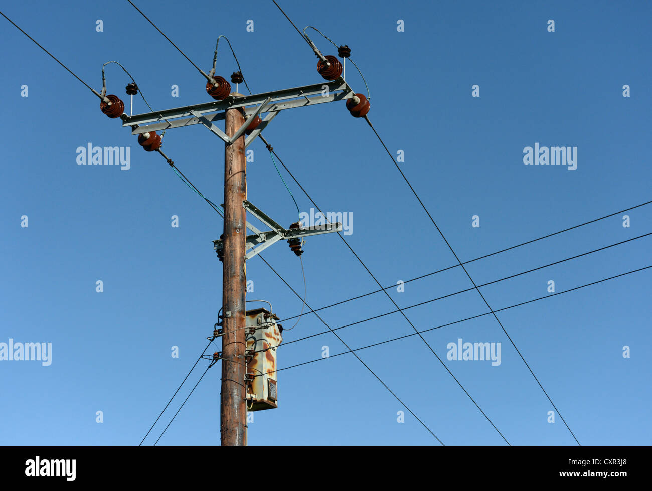 11-kv-overhead-electrical-power-lines-and-transformer-on-wooden-pole-CXR3J8.jpg