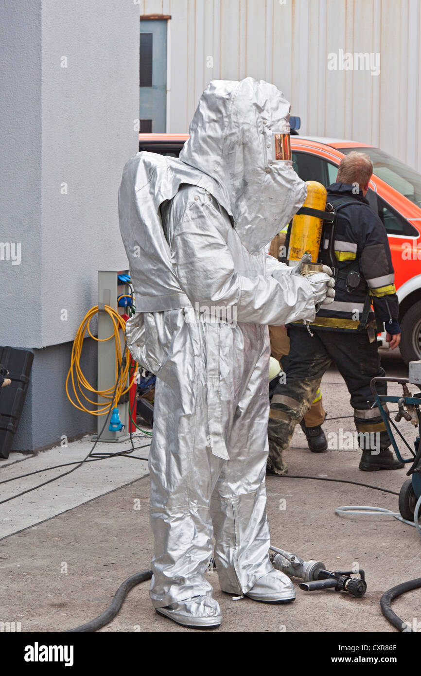 Firefighter, heat and flame proof clothing, protective clothing, fire brigade - Stock Image