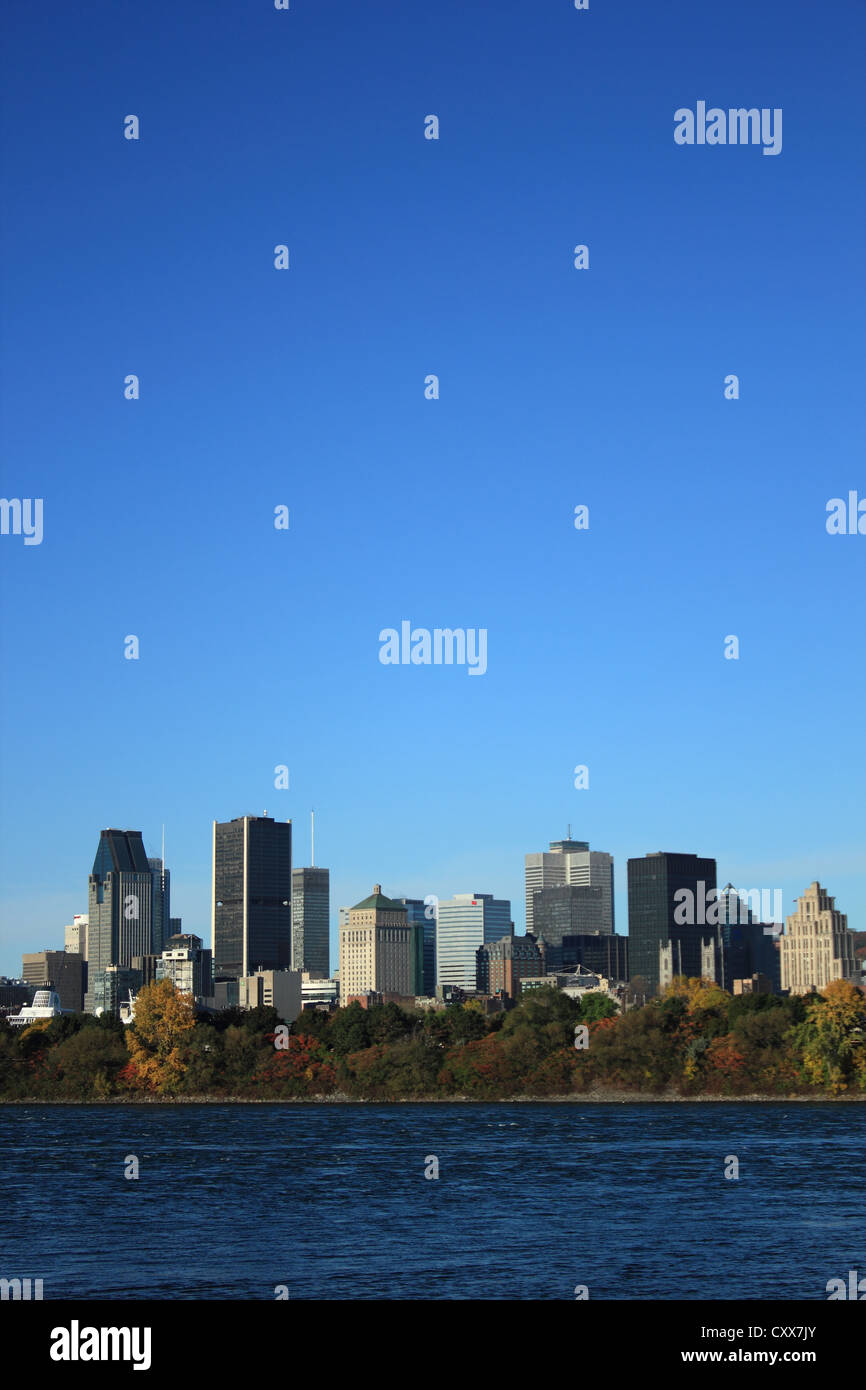 Early morning view of skyline with old Montreal in foreground, across St. Lawrence River, Montreal, Quebec, Canada. - Stock Image