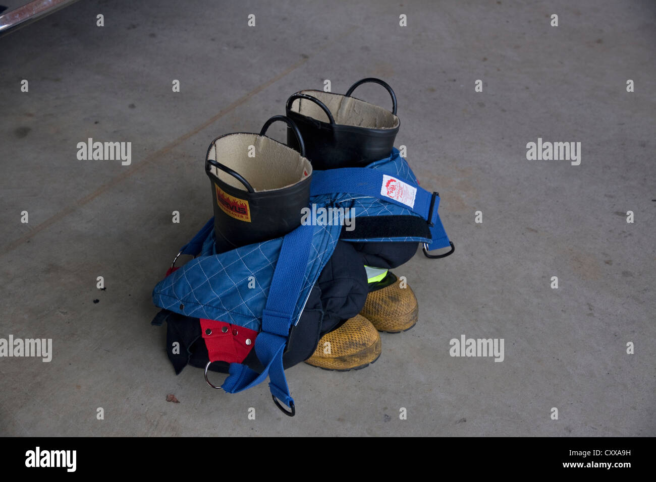 Firefighter turn-out gear, boots and pants Eastern USA - Stock Image