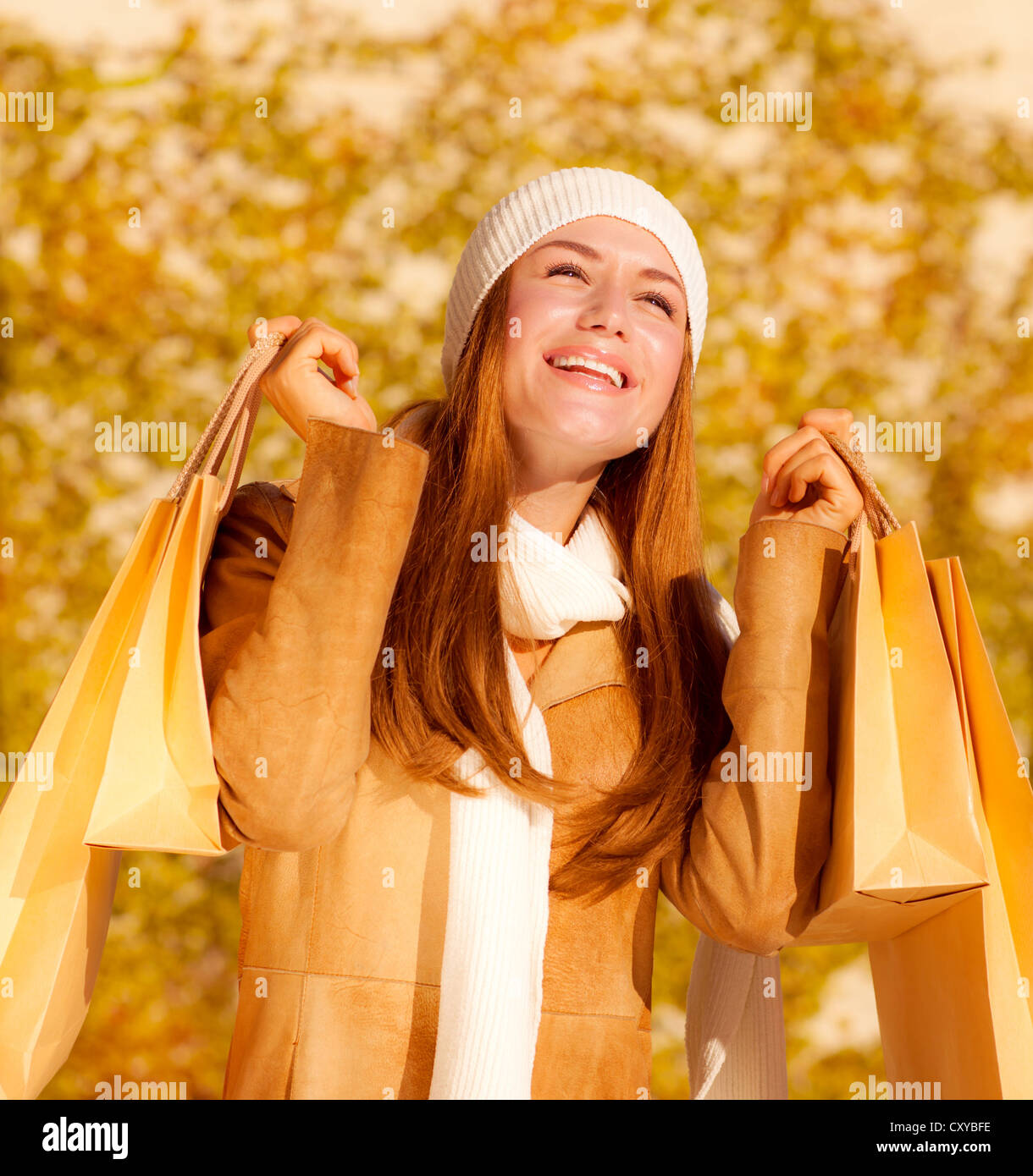 Picture of cute cheerful girl with shopping bags, attractive stylish woman rejoice her presents bags, pretty female - Stock Image