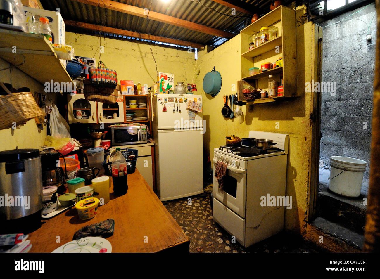 Humble kitchen in a poor neighborhood, El Esfuerzo slum, Guatemala City, Guatemala, Central America - Stock Image