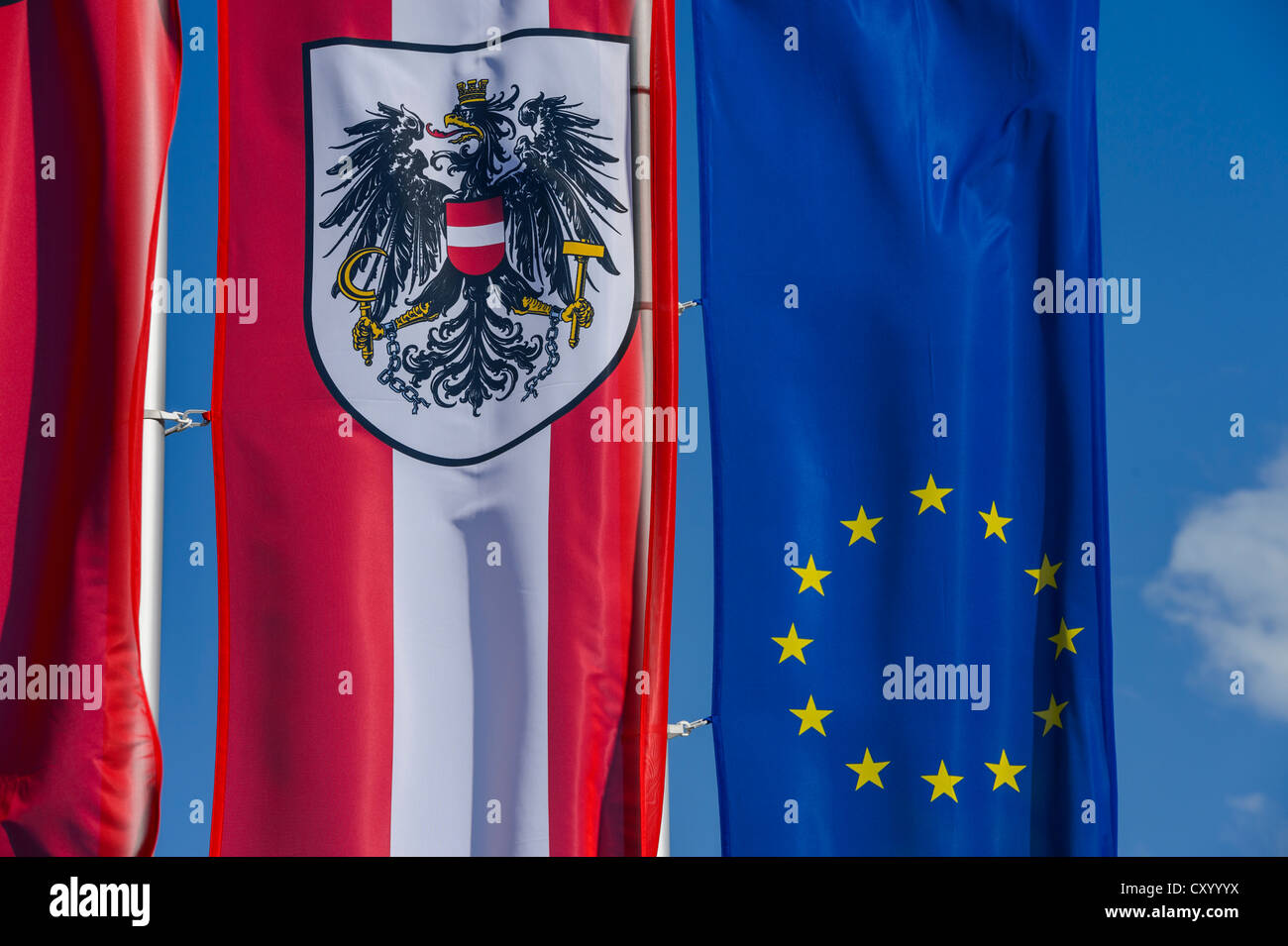 Flags of the Republic of Austria and the EU, forecourt of the 'Tirol Panorama' Museum, at Bergisel, Innsbruck, - Stock Image