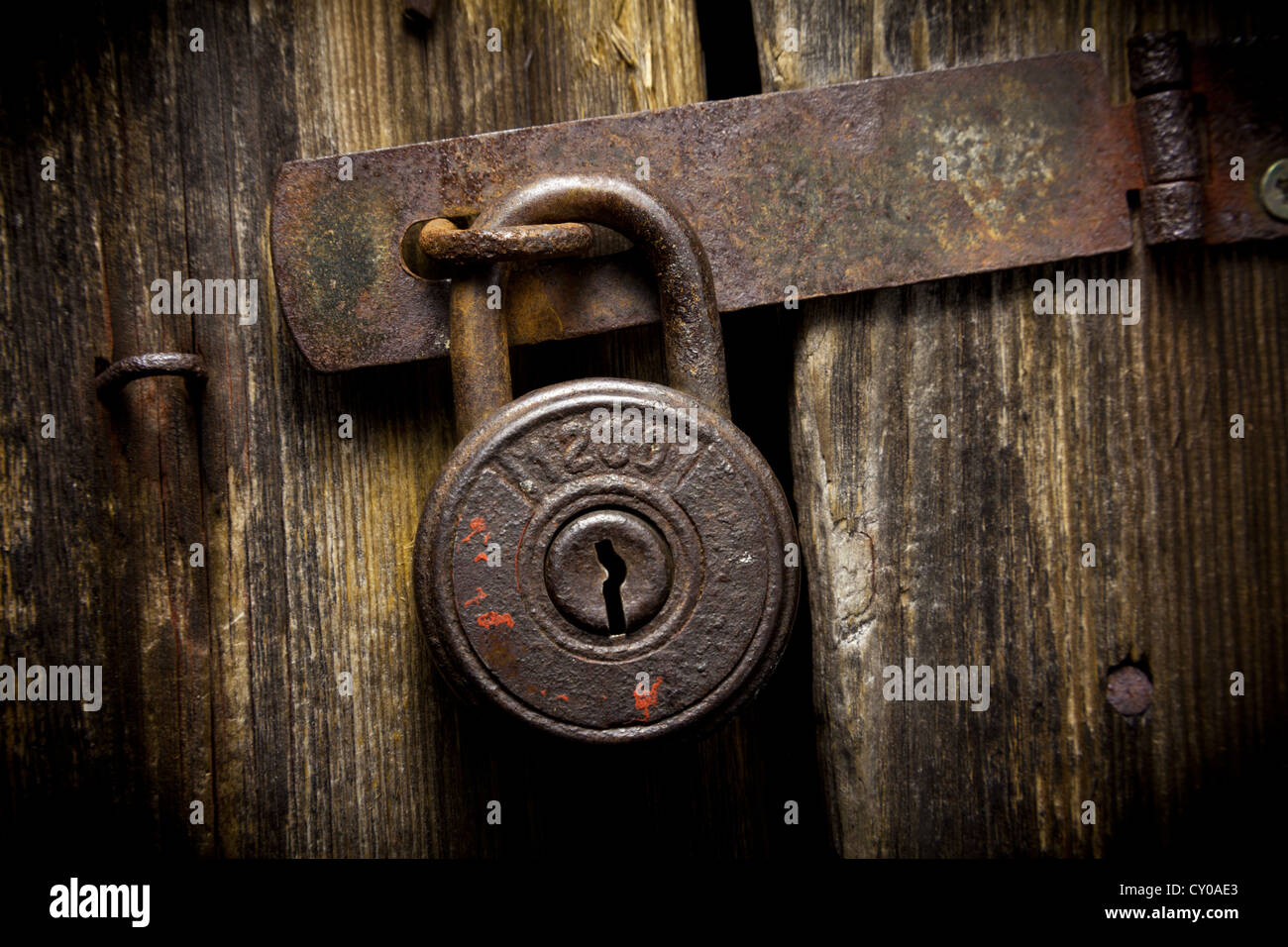 Rusty padlock with numbers - Stock Image