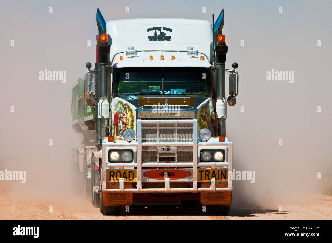 Road Train in a dust cloud on a desert track. - Stock Image