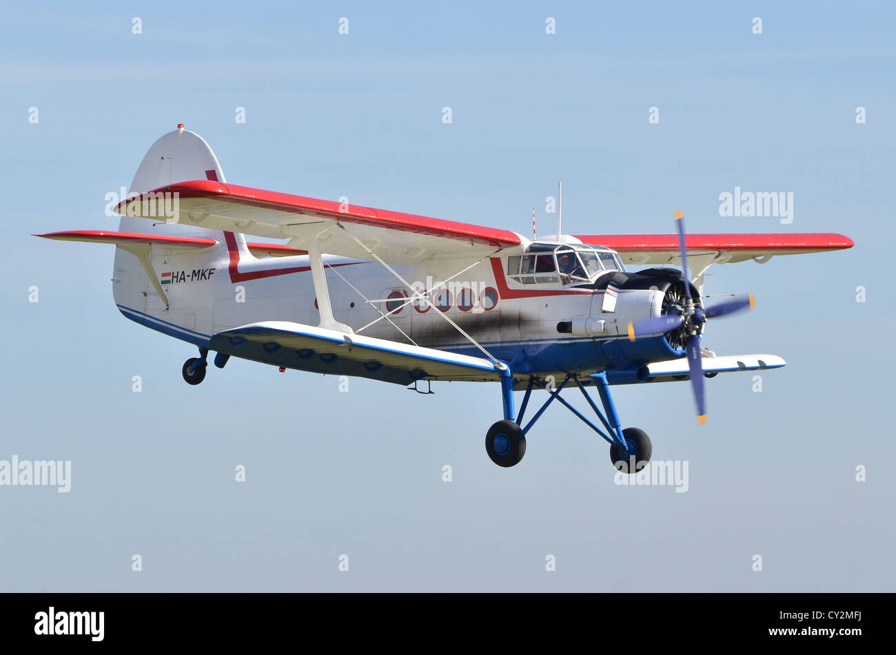 Antonov An-2TP biplane displaying at Duxford Airshow 2012 - Stock Image
