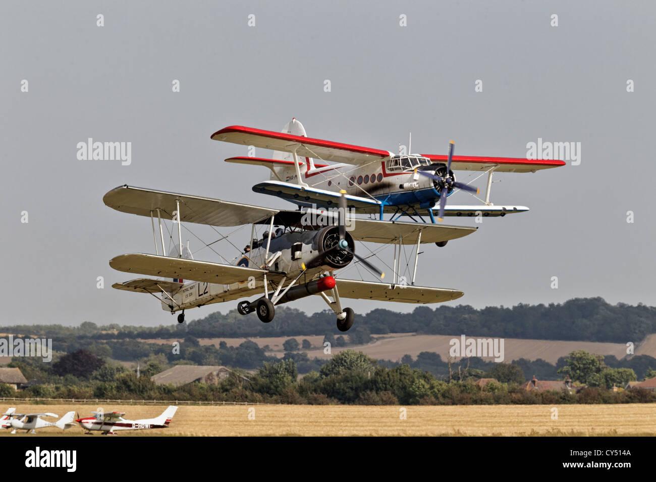 Fairey Swordfish and Antonov AN2 pairs take off - Stock Image
