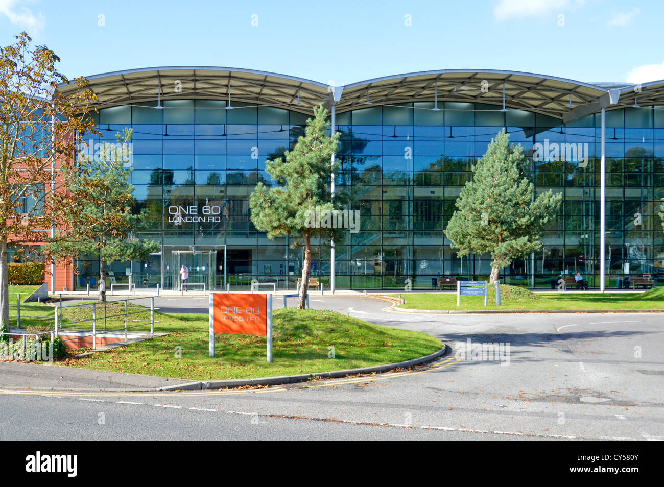 Modern glass office building full height glazing to main elevation in landscaped setting located close to Sevenoaks - Stock Image