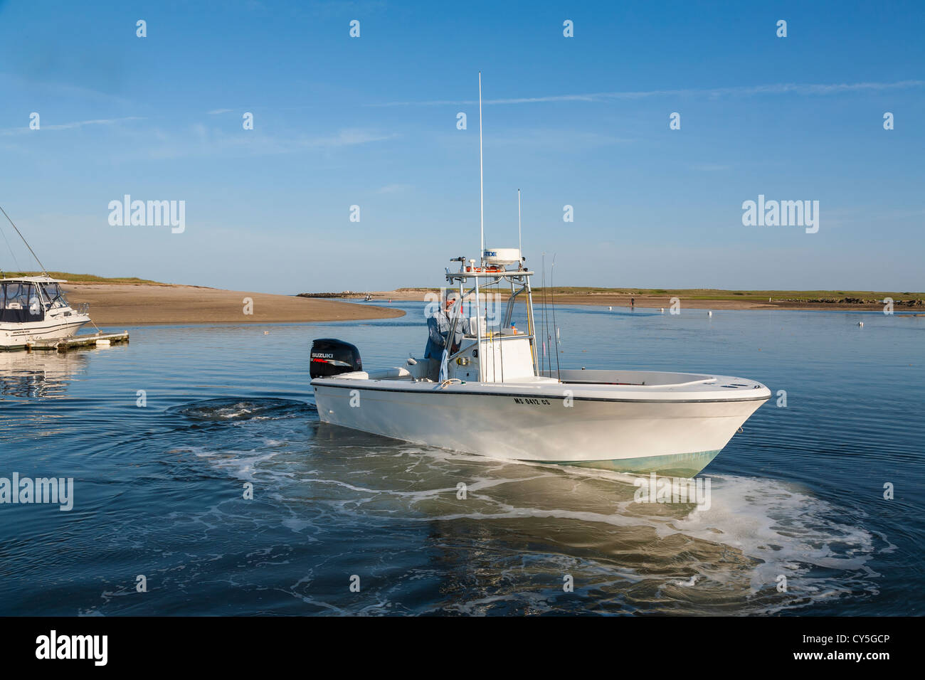 Good Skippers Cape Cod Part - 4: Charter Boat Skipper Maneuvers Off Dock. Pamet River Boat Ramp. Cape Cod.  USA.