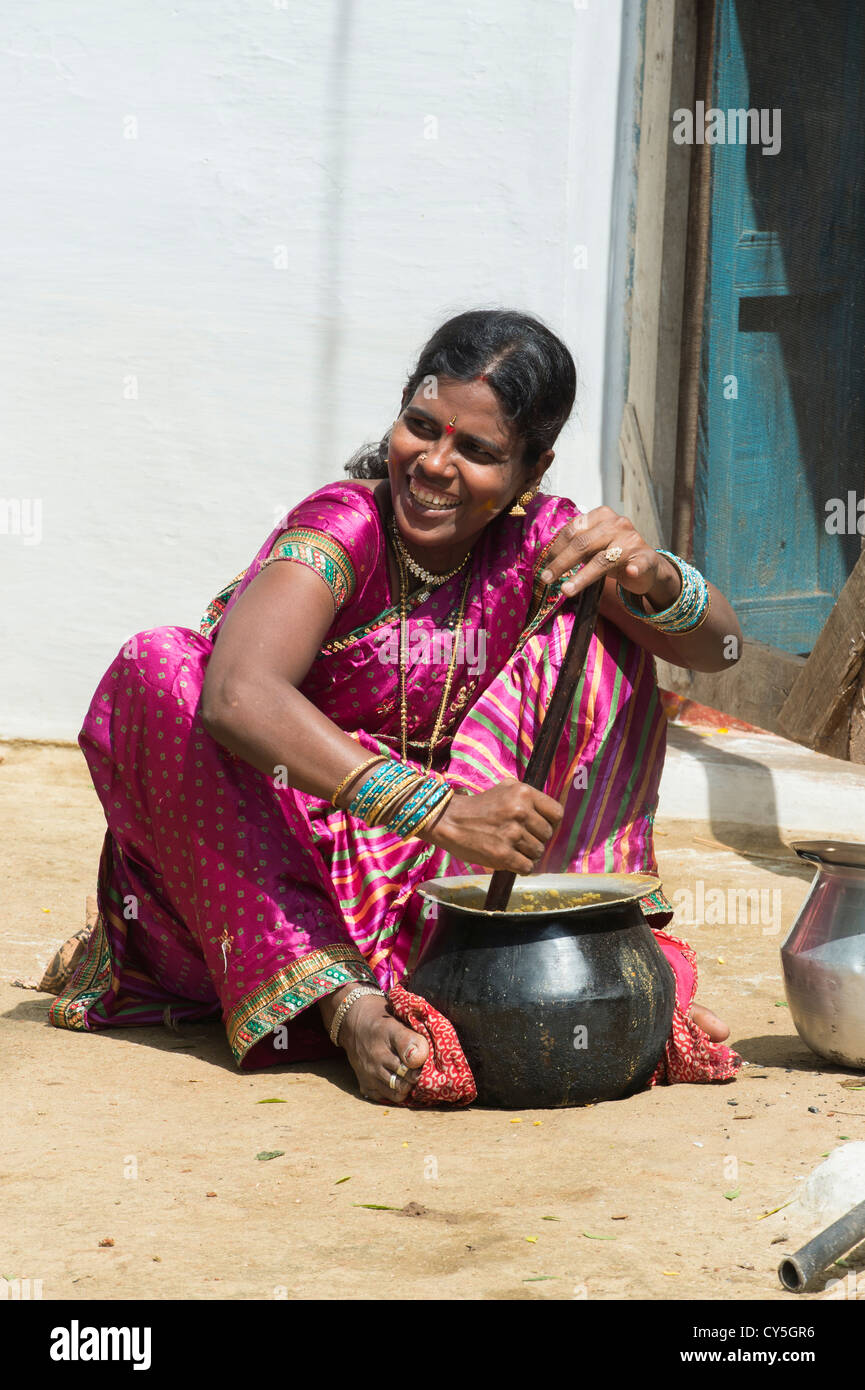 https://c7.alamy.com/comp/CY5GR6/indian-woman-mixing-dal-for-dasara-festival-food-in-a-rural-indian-CY5GR6.jpg Indian Woman Cooking