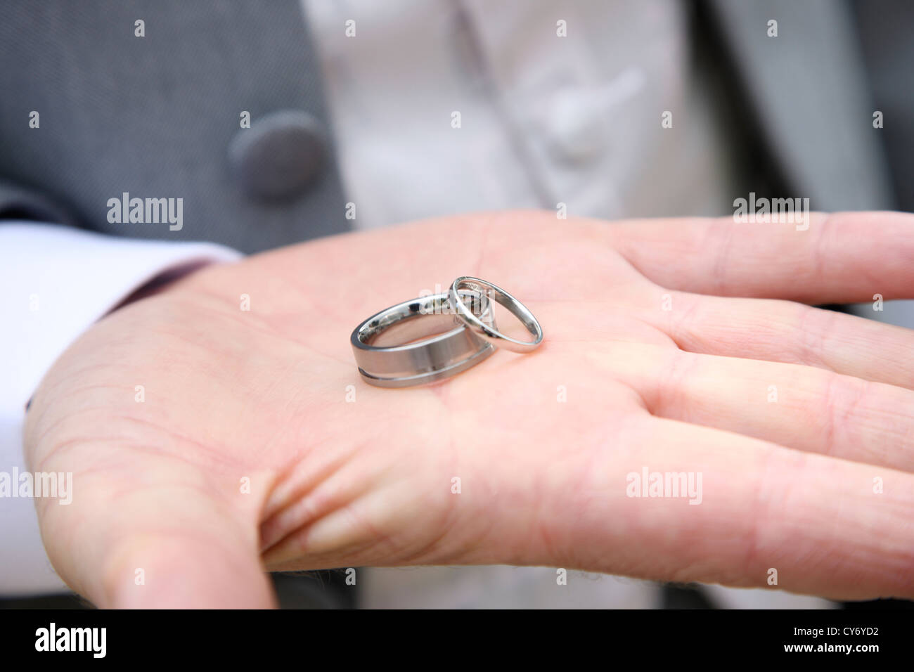 Bestman holding wedding rings in palm of hand on wedding day Stock ...