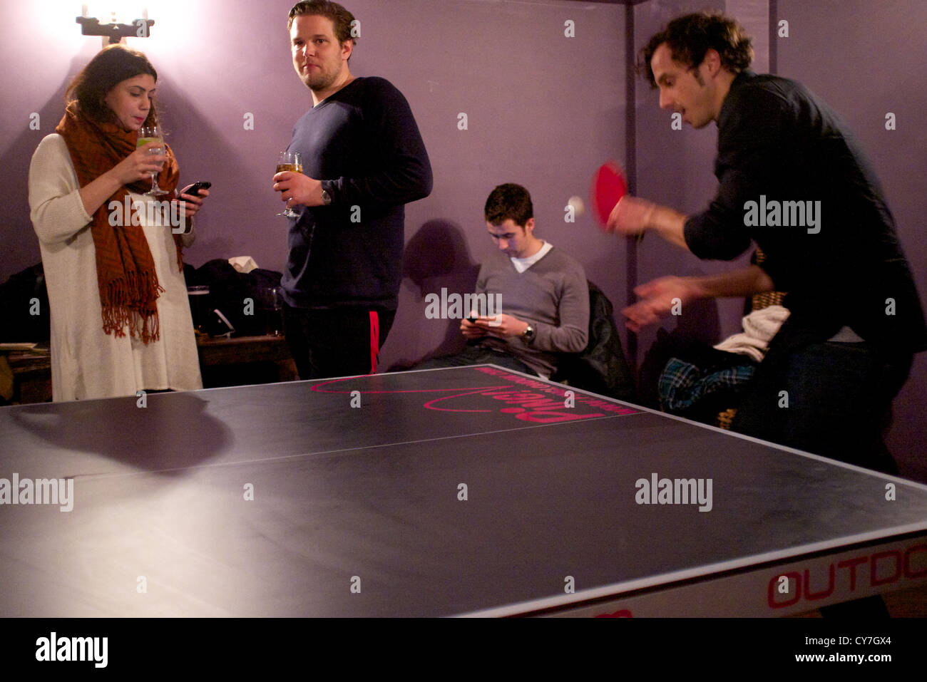 Ping Pong in London. Playing table tennis in a pub in the trendy Clerkenwell area of London. - Stock Image