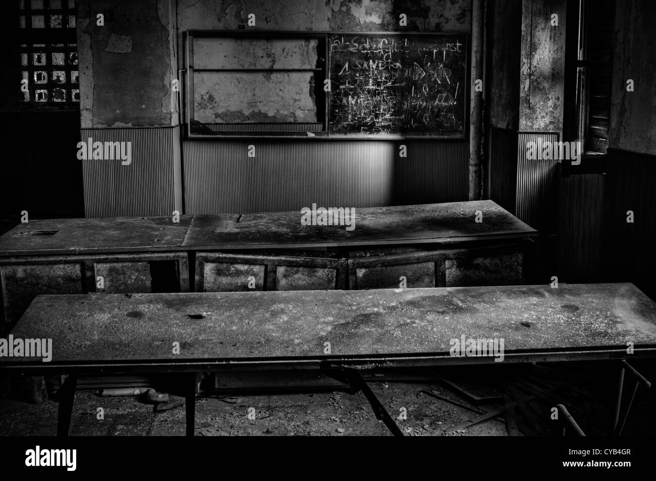 Italy. Ruined classroom in abandoned school - Stock Image