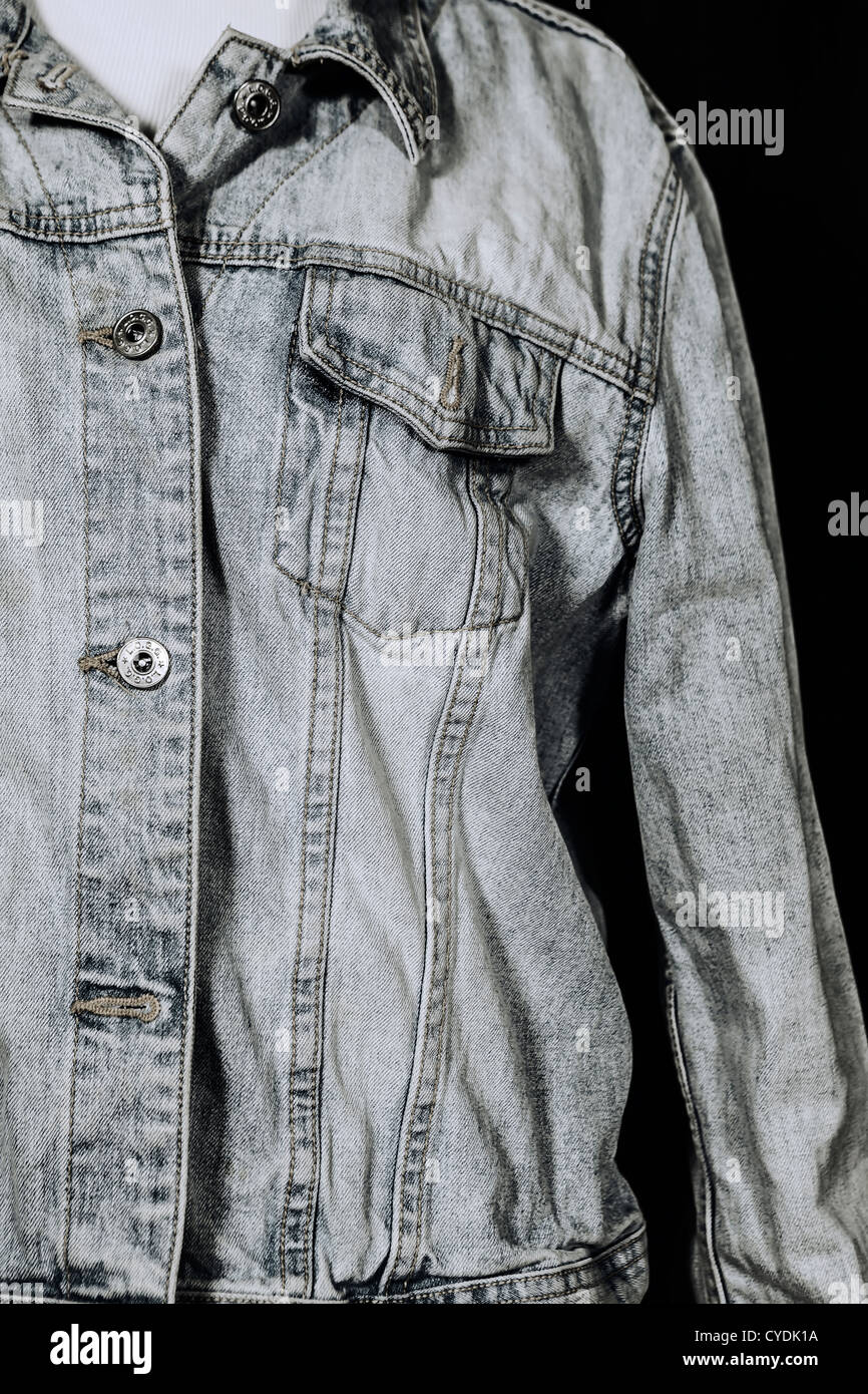 an old denim jacket - Stock Image