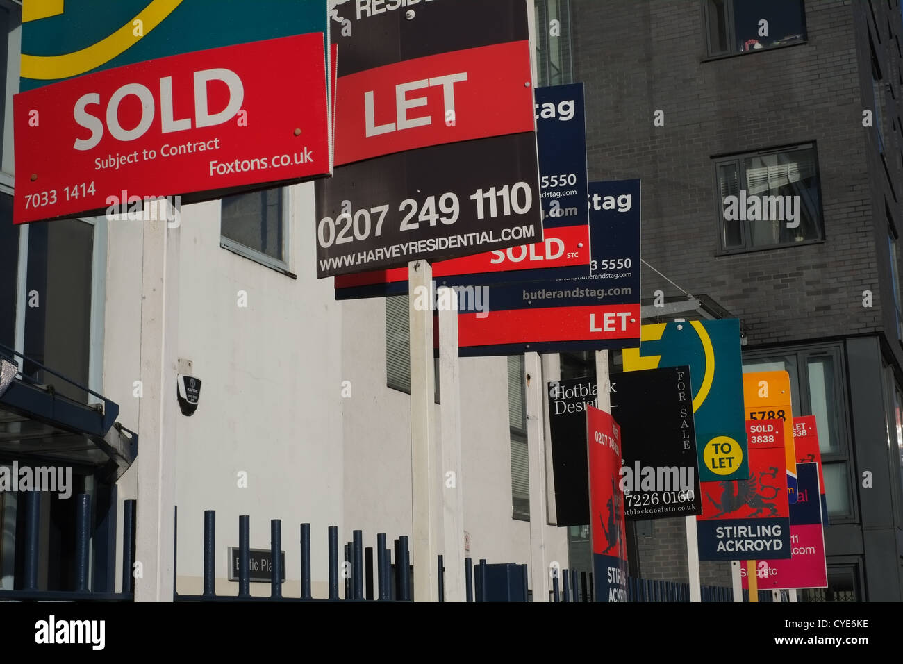 Estate agents' signs in London, UK Stock Photo
